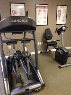 A photo of a treadmill and an exercycle at the Fit Club